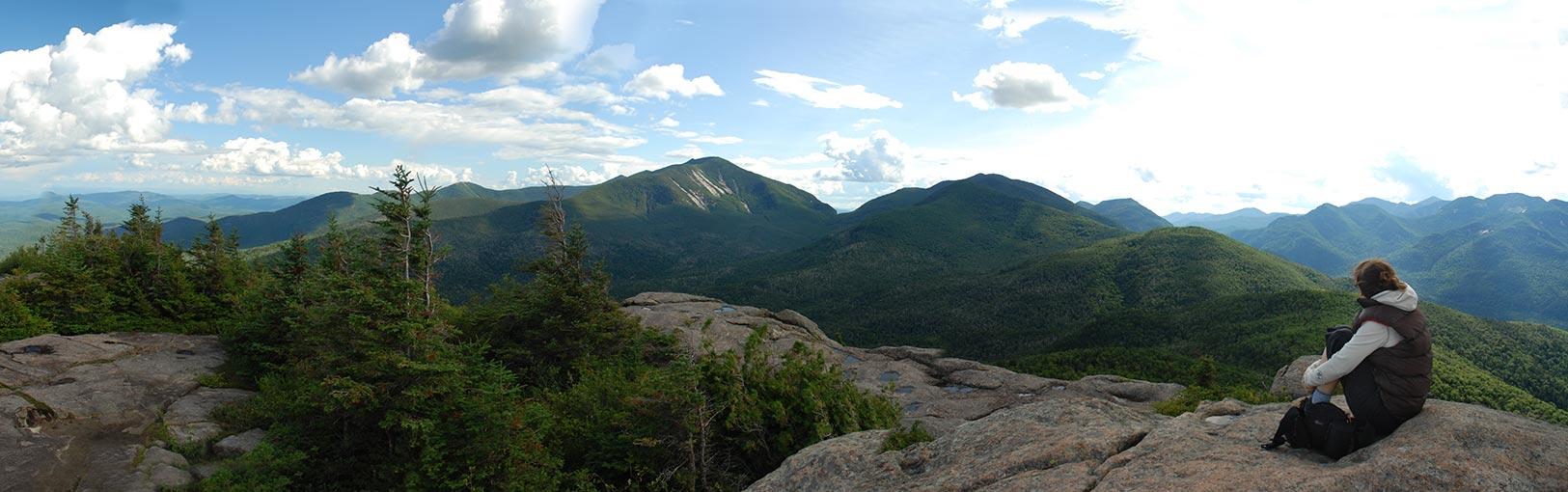 Sitting on mountain top after hiking local Adirondack High Peak
