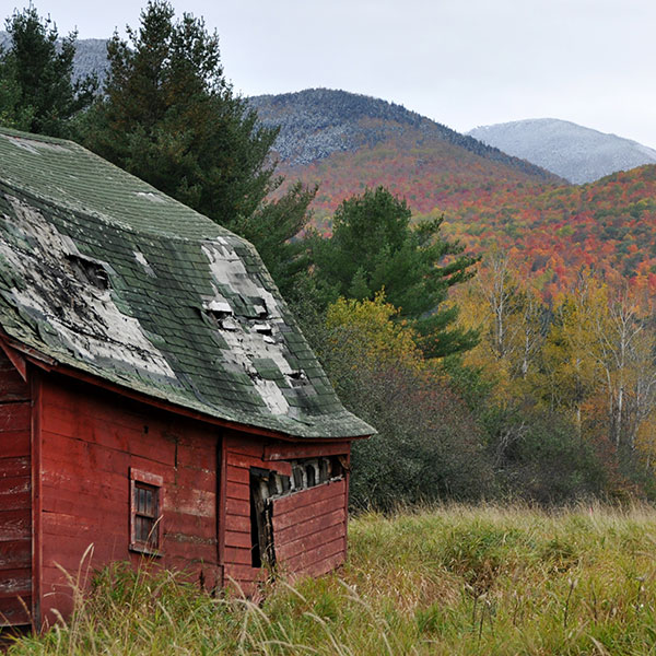 Keene's Red barn in a field during fall hike