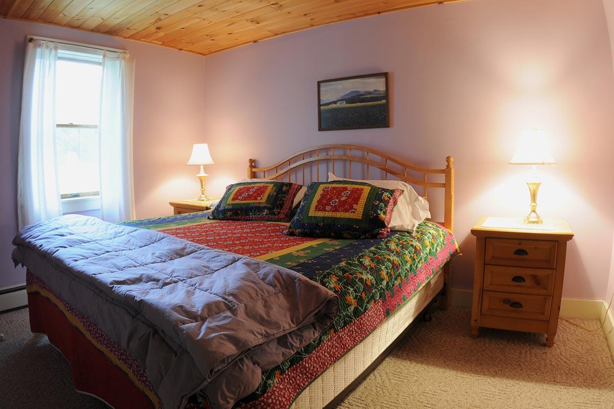 Notman Suite king bed with wood nightstands