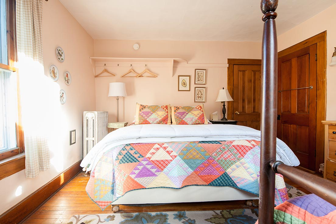 Room 3's queen bed from sitting on the twin bed