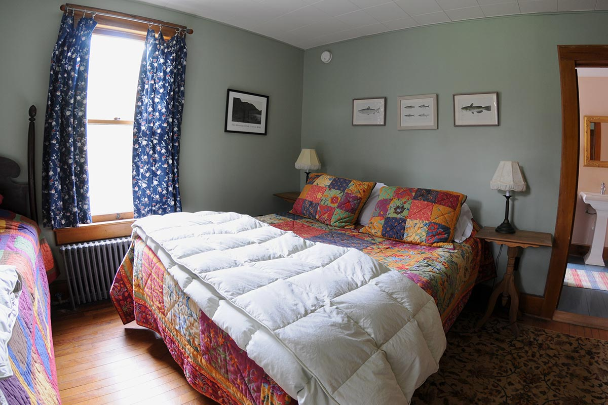 On of Room 4's two twin beds