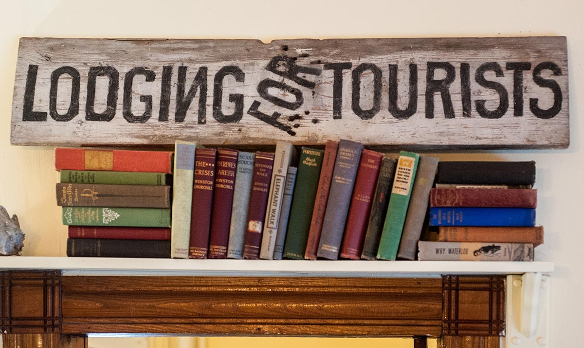 Lodging for Tourists sign above books