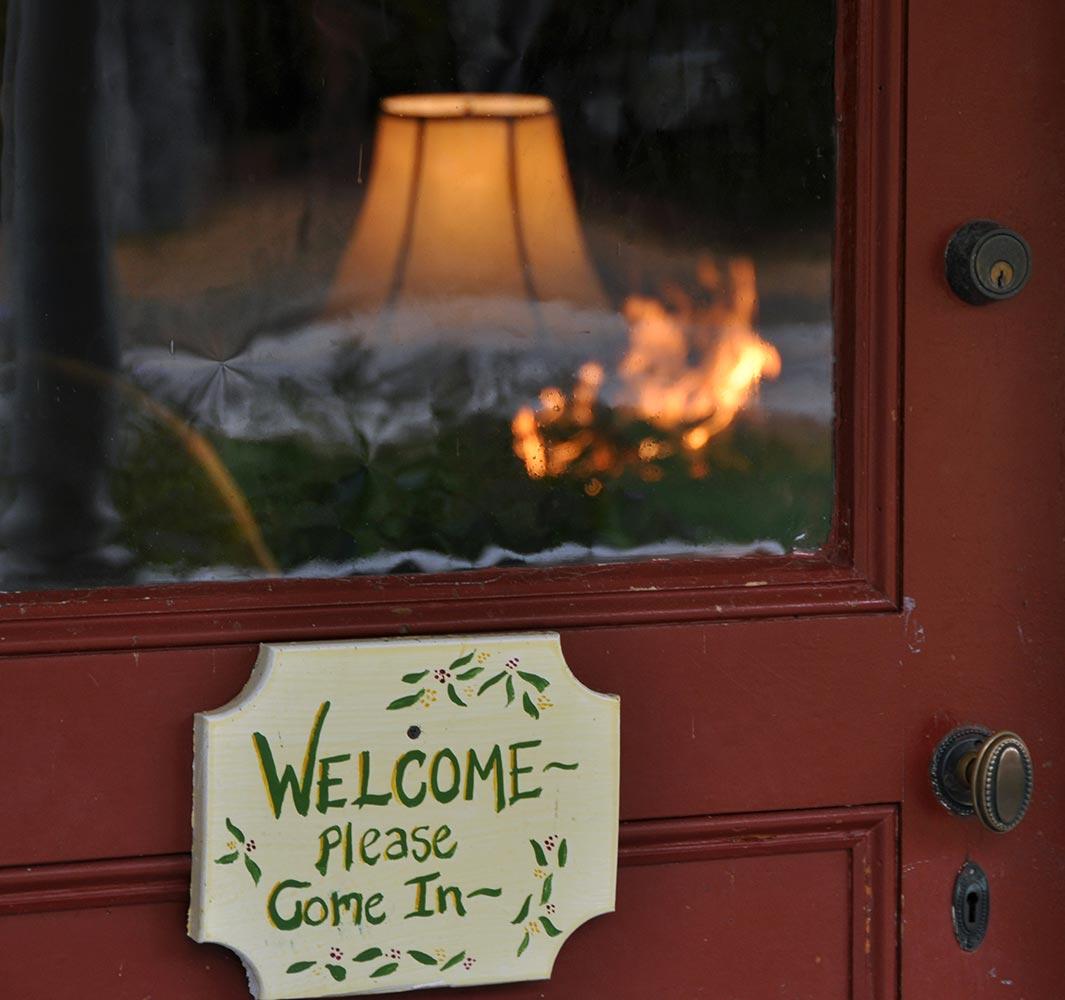 Welcome sign on front door