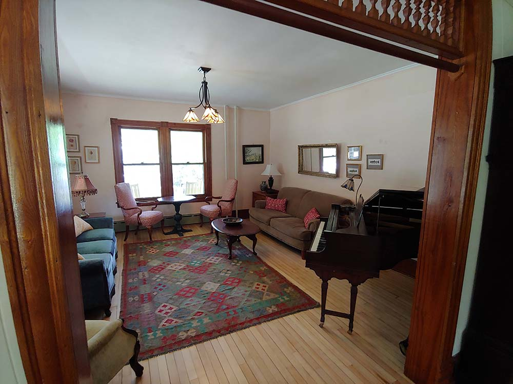 living room with couches and piano