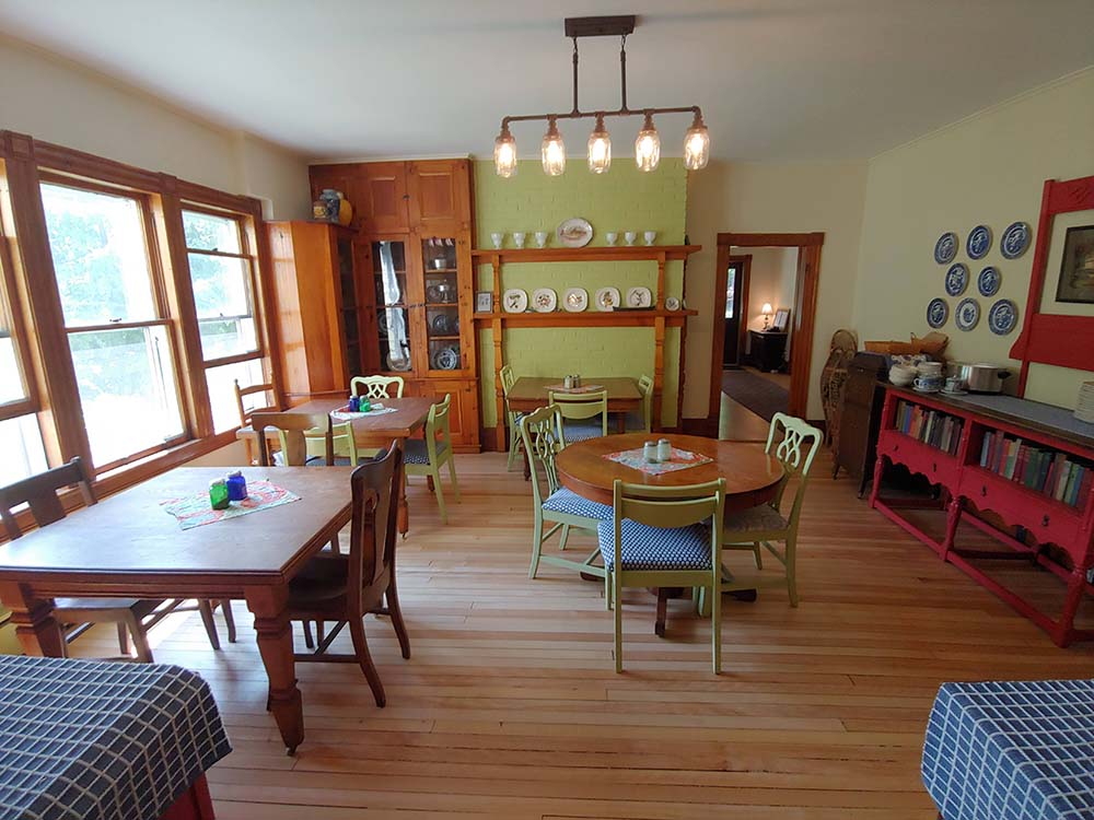 dining area with small tables and chairs