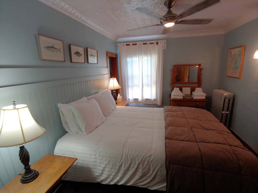 bedroom with bed and light blue walls