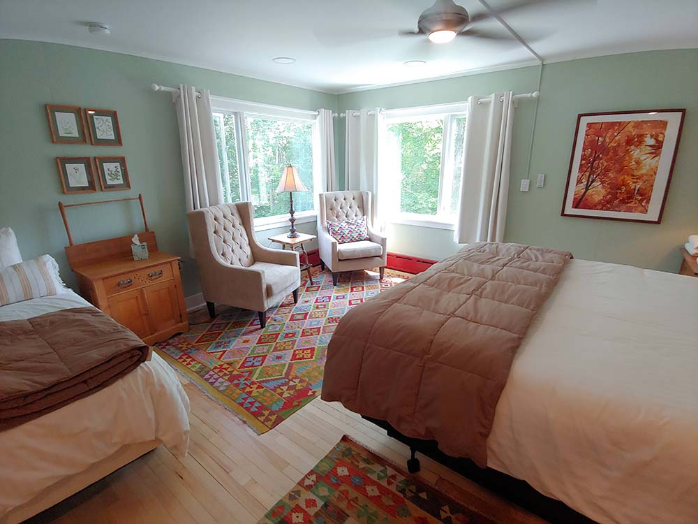 bedroom with 2 beds and chairs